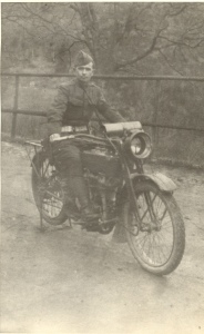 Pvt. A.L. Gooch on his motorcycle, WWI 89th Div., Military Police